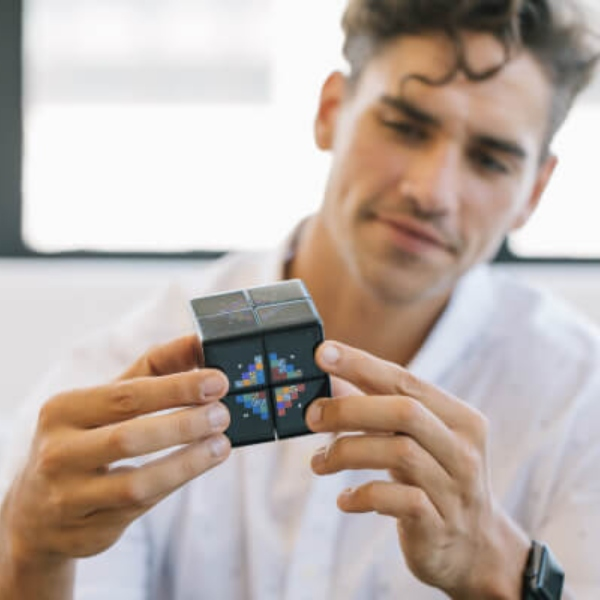 Man playing with the new WowCube video game F